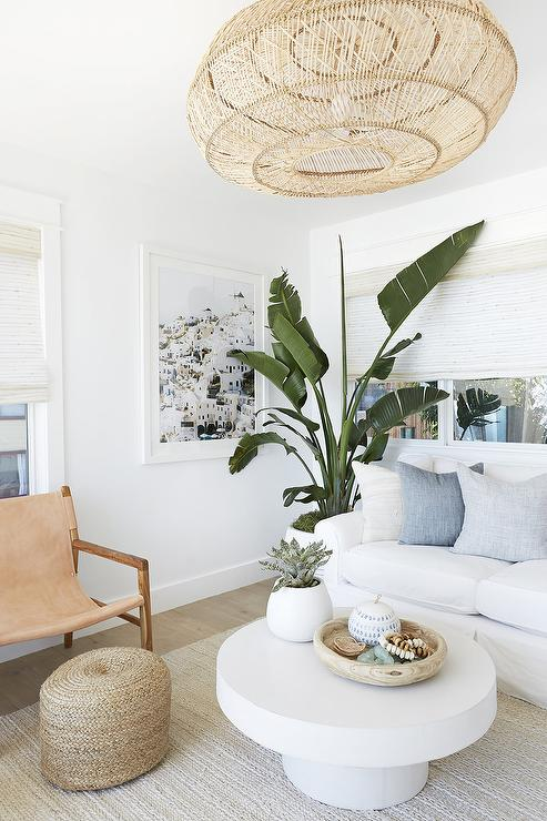 white pedestal coffee table on seagrass