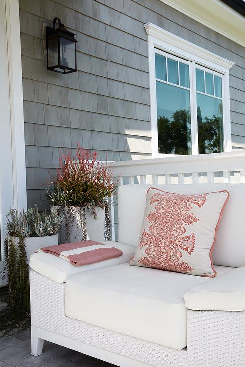white wicker outdoor chair with white