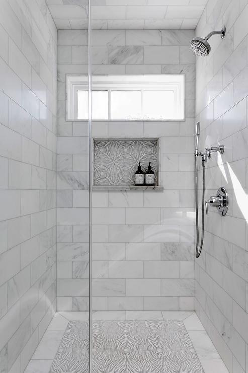calcutta marble subway tiles on shower