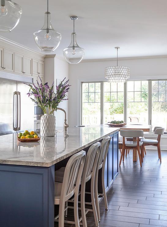 blue kitchen island with three kichler