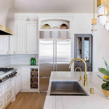 stainless steel sink with gold faucet