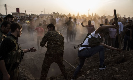Syrians bury Syrian Democratic Forces fighters killed fighting Turkish advance in the Syrian town of Qamishli, Saturday, Oct. 12, 2019,