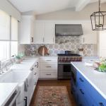 Classic White Kitchen With Blue Island And Vintage Runner By