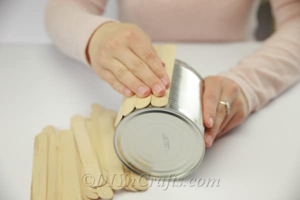 Covering entire empty can with popsicle sticks