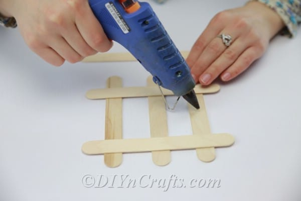 Gluing down popsicle stick coaster