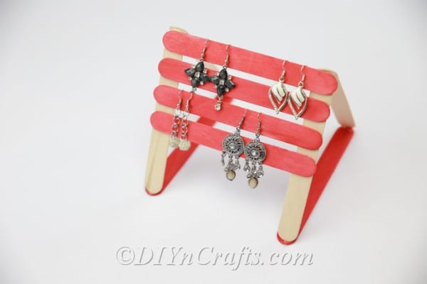 Earring organizer made from popsicle sticks with earrings