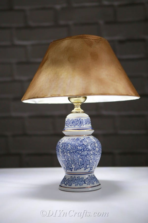 A solar garden lamp on a table emitting light.