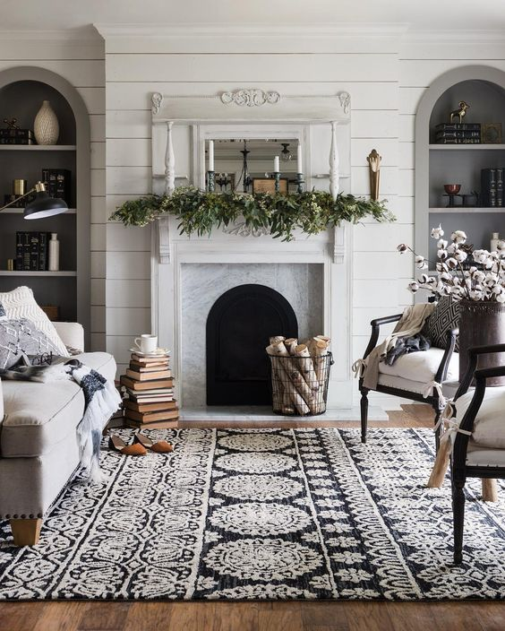 25 Winter Fireplace Mantel Decorating Ideas Winter mantel greenery and taper candles