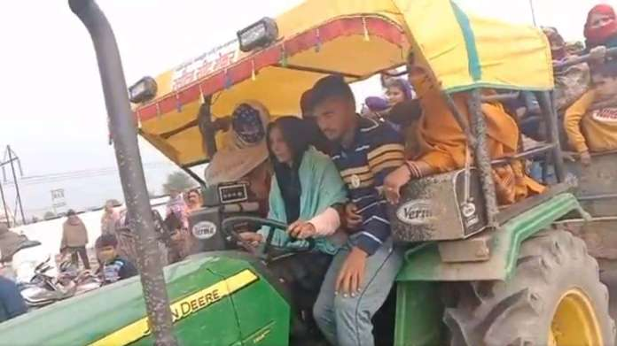 Woman driving tractor to join farmer protests