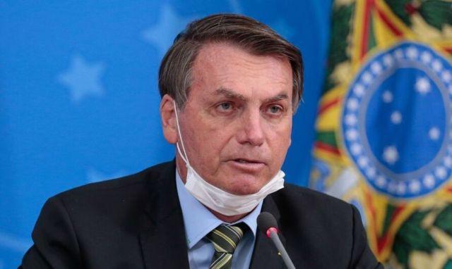 Imagem ilustrativa da notícia Bolsonaro é multado por não usar máscara em motociata
