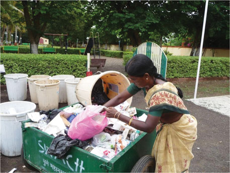 SWaCH workers collect discarded sanitary napkins in pink polythene bags
