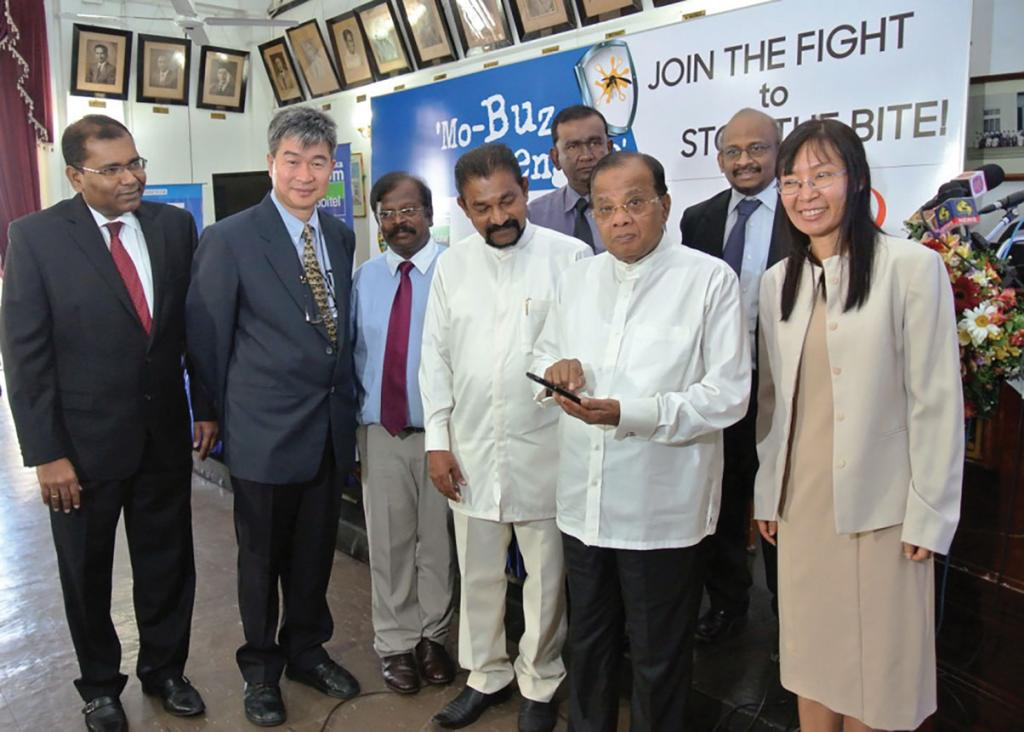 Colombo mayor A J M Muzammil (second from right) launches the Mo-Buzz application for mapping dengue hotspots at the Colombo Municipal Council on February 12, 2015. Hawker (Courtesy: mo-buzz.org)