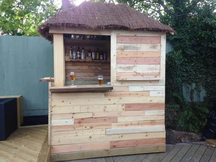 DIY Outdoor Pallet Bar with Pyramid Style Roof - Easy ... on Backyard Bar With Roof id=66624
