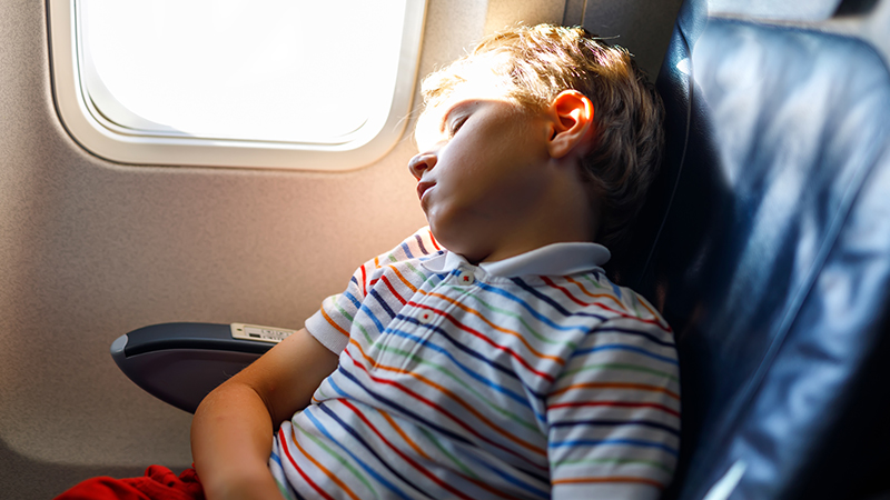 how to stay sane while flying with young kids, child sleeping