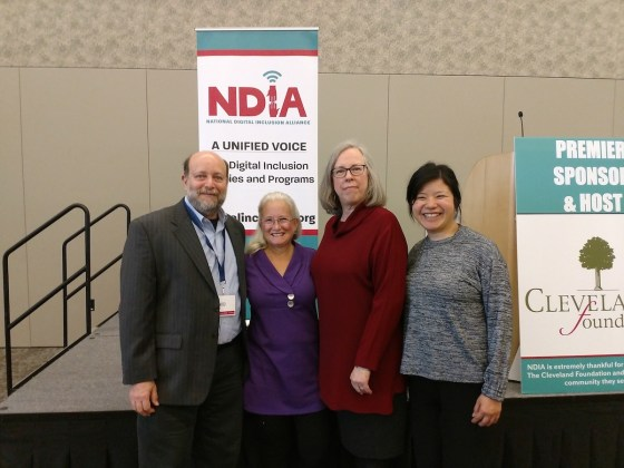 A picture of Deb Socia with past winners of the NDIA award.