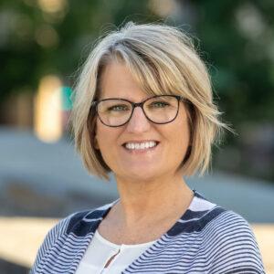 This photo shows a headshot of Nancy Tucker.