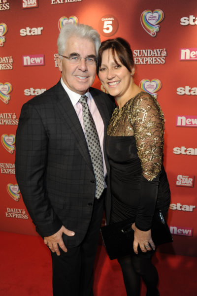 Max Clifford with his second wife Jo at a red carper event (Credit: Splash)