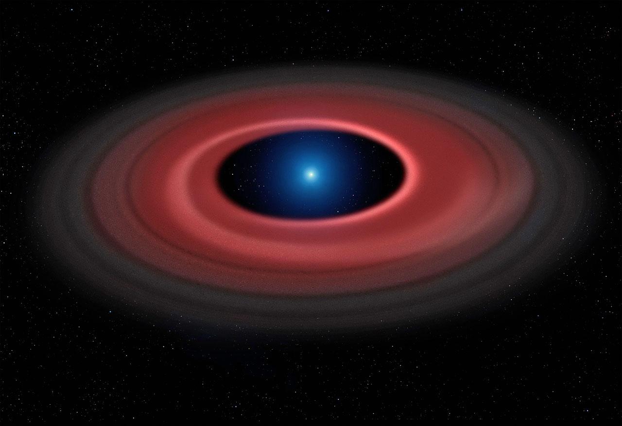 Esta impresión artística muestra cómo un asteroide destrozado por la fuerte gravedad de una enana blanca ha formado un anillo de partículas de polvo y escombros que orbitan alrededor de un calcinado núcleo estelar, del tamaño de la Tierra, llamado SDSS J1228+1040. Las observaciones, realizadas a lo largo de doce años con el Very Large Telescope de ESO, han detectado el gas producido por las colisiones en el disco, revelando la presencia de un estrecho arco brillante.