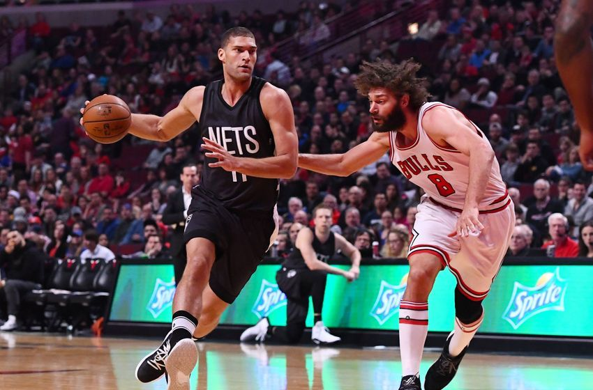 Dec 28, 2016; Chicago, IL, USA; Brooklyn Nets center Brook Lopez (11) dribbles the ball against Chicago Bulls center Robin Lopez (8) during the first half at the United Center. Mandatory Credit: Mike DiNovo-USA TODAY Sports