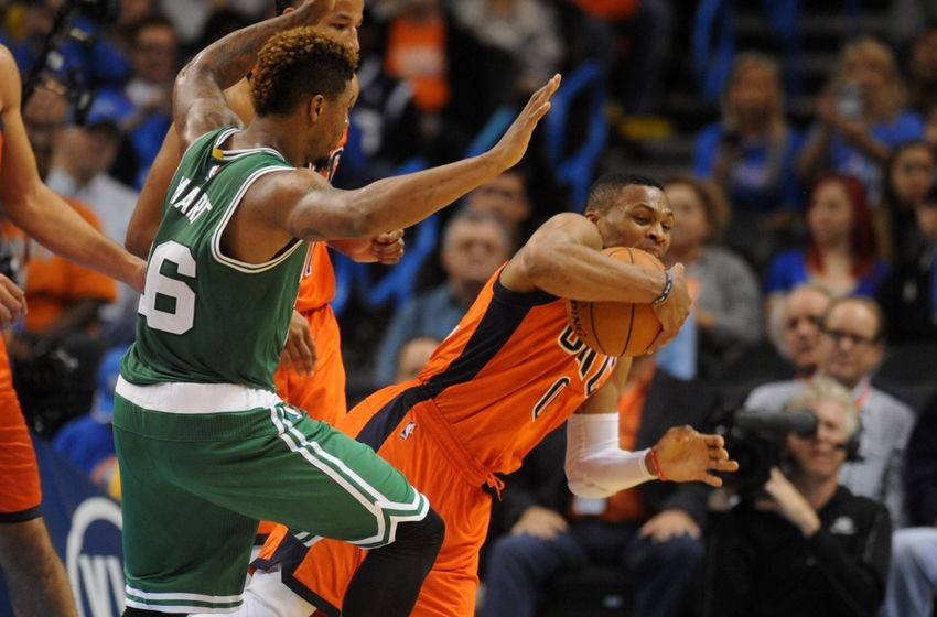 Nov 15, 2015; Oklahoma City, OK, USA; Oklahoma City Thunder guard Russell Westbrook (0) dives for a rebound in front of Boston Celtics guard Marcus Smart (36) during the third quarter at Chesapeake Energy Arena. Mandatory Credit: Mark D. Smith-USA TODAY Sports