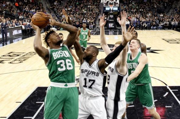 Dec 14, 2016; San Antonio, TX, USA; Boston Celtics point guard Marcus Smart (36) shoots the ball as San Antonio Spurs shooting guard Jonathon Simmons (17) defends during the first half at AT&T Center. Mandatory Credit: Soobum Im-USA TODAY Sports