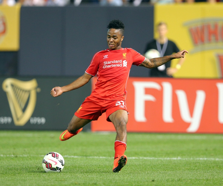 Jul 30, 2014; Bronx, NY, USA; Liverpool FC forward Raheem Sterling (31) controls the ball against Manchester City FC during the second half of a game at Yankee Stadium. Mandatory Credit: Brad Penner-USA TODAY Sports