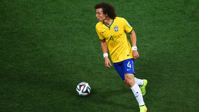 SAO PAULO, BRAZIL - JUNE 12: David Luiz of Brazil in action during the 2014 FIFA World Cup Brazil Group A match between Brazil and Croatia at Arena de Sao Paulo on June 12, 2014 in Sao Paulo, Brazil. (Photo by Elsa/Getty Images)