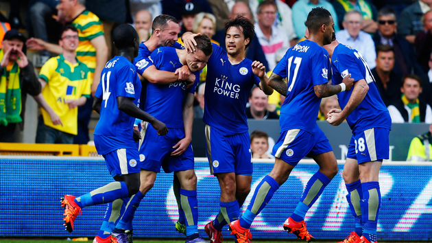 NORWICH, ENGLAND - OCTOBER 03: Jamie Vardy (3rd L) of Leicester City celebrates scoring his team's first goal with his team mates during the Barclays Premier League match between Norwich City and Leicester City at Carrow Road on October 3, 2015 in Norwich, United Kingdom. (Photo by Harry Engels/Getty Images)