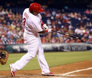 Aug 27, 2014; Philadelphia, PA, USA; Philadelphia Phillies right fielder Marlon Byrd (3) hits a single during the fourth inning of a game against the Washington Nationals at Citizens Bank Park. Mandatory Credit: Bill Streicher-USA TODAY Sports