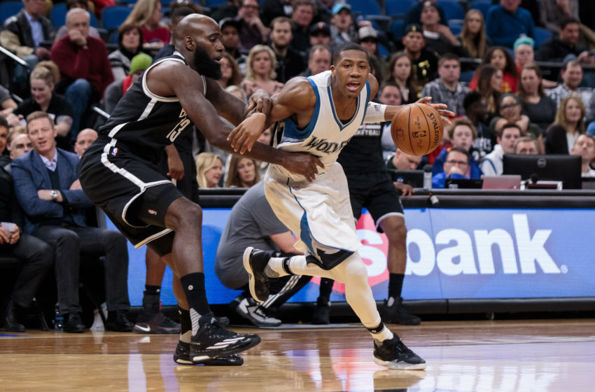 Jan 28, 2017; Minneapolis, MN, USA; Minnesota Timberwolves guard Kris Dunn (3) dribbles in the second quarter against the Brooklyn Nets forward Quincy Acy (13) at Target Center. Mandatory Credit: Brad Rempel-USA TODAY Sports