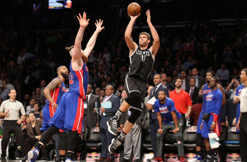 Mar 21, 2017; Brooklyn, NY, USA; Brooklyn Nets center Brook Lopez (11) shoots and makes the game winning buzzer beater over Detroit Pistons center Aron Baynes (12) during the fourth quarter at Barclays Center. Mandatory Credit: Brad Penner-USA TODAY Sports