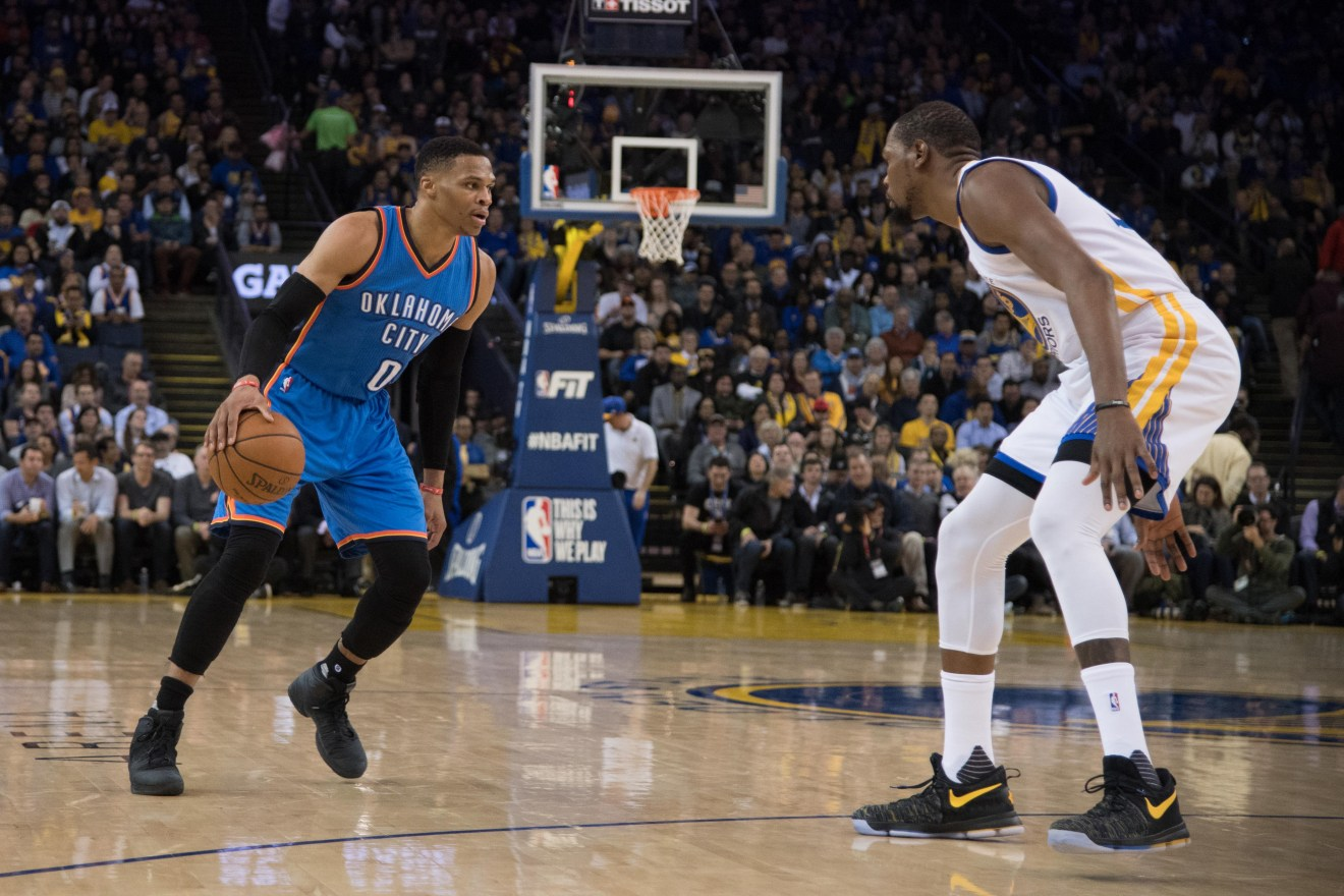 January 18, 2017; Oakland, CA, USA; Oklahoma City Thunder guard Russell Westbrook (0) dribbles the basketball against Golden State Warriors forward Kevin Durant (35) during the third quarter at Oracle Arena. The Warriors defeated the Thunder 121-100. Mandatory Credit: Kyle Terada-USA TODAY Sports