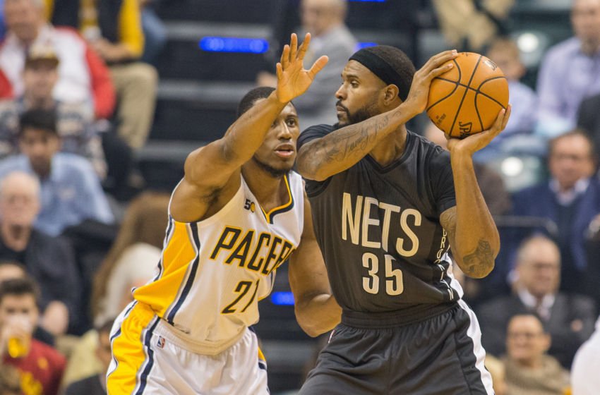 Nov 25, 2016; Indianapolis, IN, USA; Brooklyn Nets forward Trevor Booker (35) looks to pass the ball while Indiana Pacers forward Thaddeus Young (21) defends in the first half of the game at Bankers Life Fieldhouse. The Indiana Pacers beat the Brooklyn Nets 118-97. Mandatory Credit: Trevor Ruszkowski-USA TODAY Sports