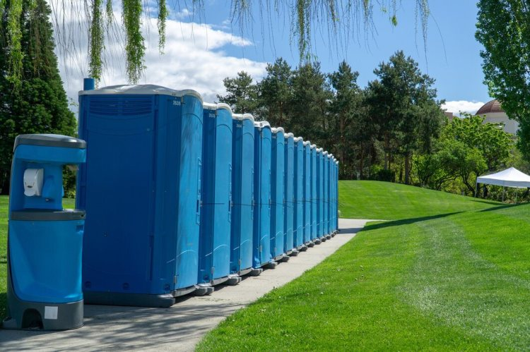 Blue Rented Portable Toilets in a Line