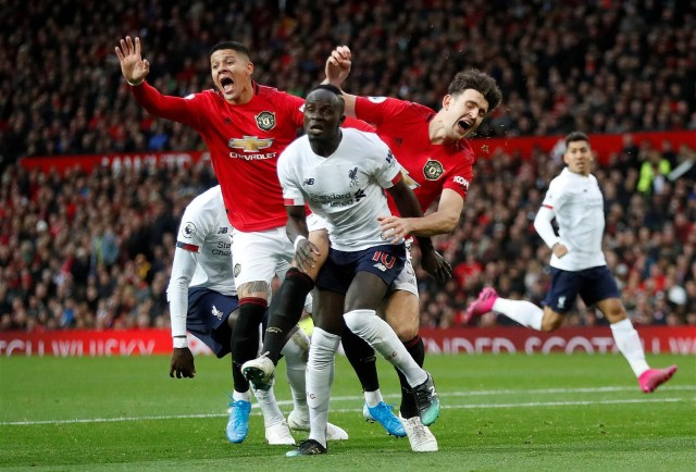 Sadio Mane gets the better of Harry Maguire and Marcos Rojo
