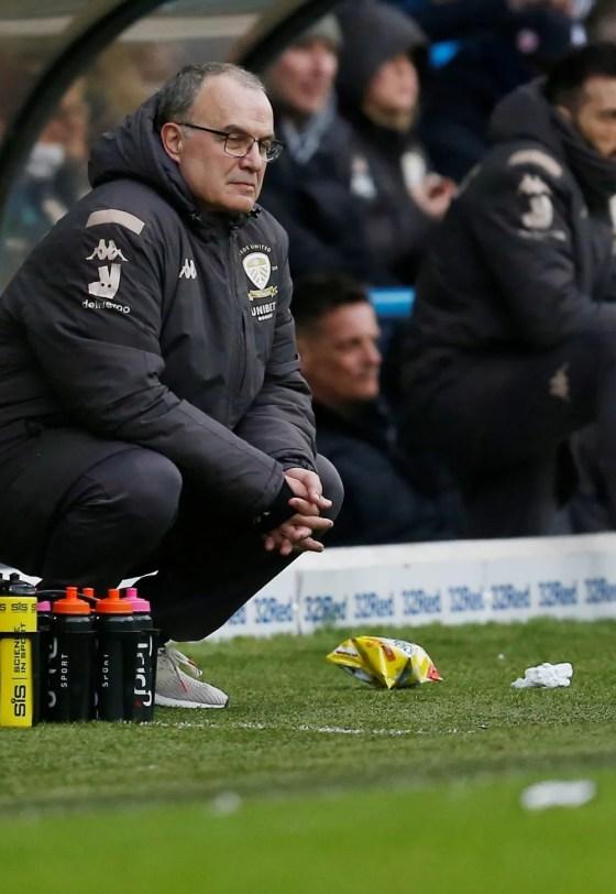 Marcelo Bielsa crouched down