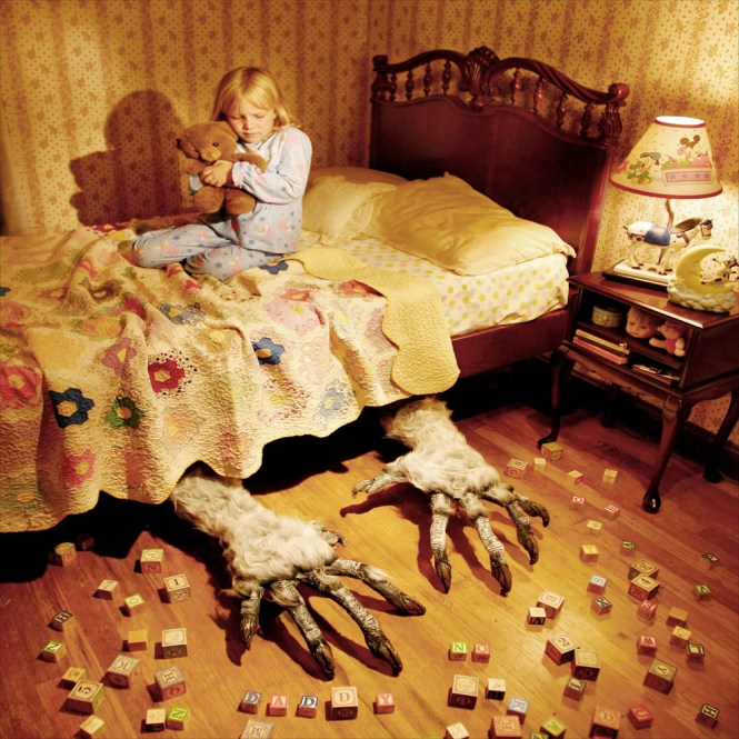 Monster under the bed in a little girls room