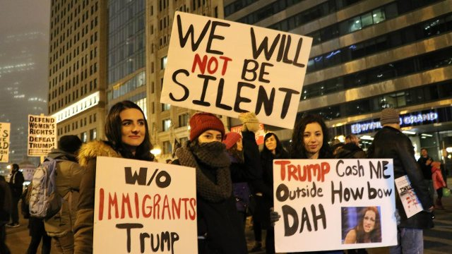 Protesters display banners reading anti-Trump slogans in Downtown Chicago on January 20, 2017 a few hours after the inauguration ceremony for Donald Trump as the 45th President of the United States.  derek henkle / AFP