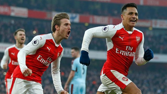 Arsenal's Chilean striker Alexis Sanchez (R) celebrates with Arsenal's Spanish defender Nacho Monreal (2nd L) after scoring their late winner from the penalty spot during the English Premier League football match between Arsenal and Burnley at the Emirates Stadium in London on January 22, 2017. Arsenal won the game 2-1. Ian KINGTON / AFP