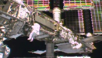 Spacewalkers at space station
