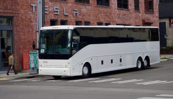 Amazon launches stealthy employee shuttle system with nondescript buses and little fanfare