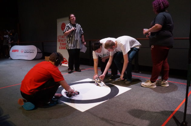 Teams prepare to being the final match in the Unified Robotics High School Championship. (GeekWire Photo / Clare McGrane)