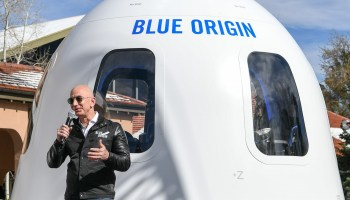 Jeff Bezos with Blue Origin New Shepard crew capsule mock-up