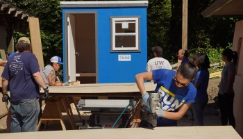 TUNE employees build a tiny home for the Pod Project in effort to address homelessness