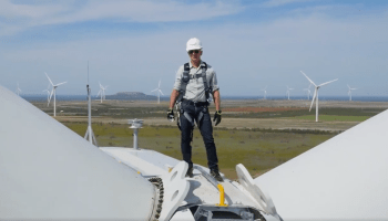 Watch Jeff Bezos open Amazon's new Texas wind farm, perched atop a giant windmill like an action star