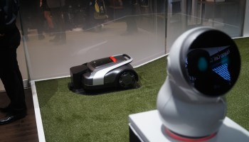 I welcome our robot overlords, as long as they'll mow my lawn like this LG gadget does