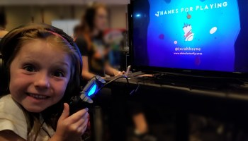 Tim's daughter Maezie enjoyed the Donut County demo at PAX