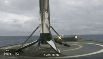 SpaceX's Falcon Heavy center core booster falls over on ship amid heavy seas