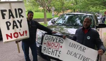 Uber and Lyft drivers roll up to Seattle City Hall to demand better wages and worker protections
