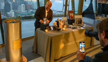 One share of Amazon stock at $1,780 joins other mementos inside Space Needle time capsule